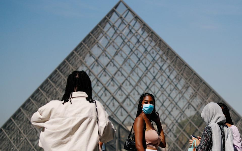 Visitors to the Louvre in the summer - Reuters