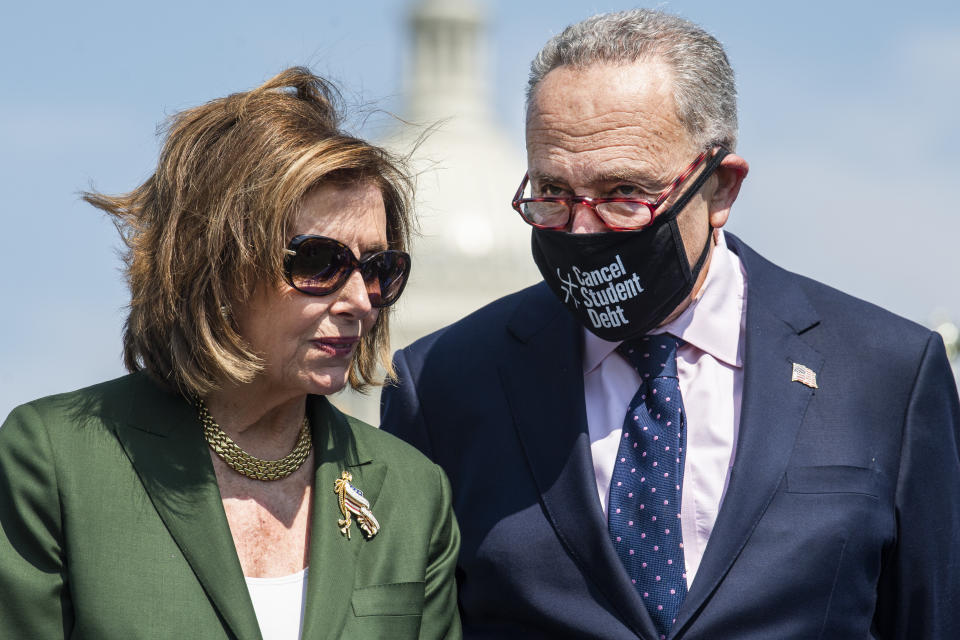 Speaker of the House Nancy Pelosi, D-Calif., and Senate Majority Leader Charles Schumer, D-N.Y., attend a rally with Paid Leave for All to advocate for paid family and medical leave, near the Capitol Reflecting Pool on August 04, 2021. (Tom Williams/CQ Roll Call via Getty Images)