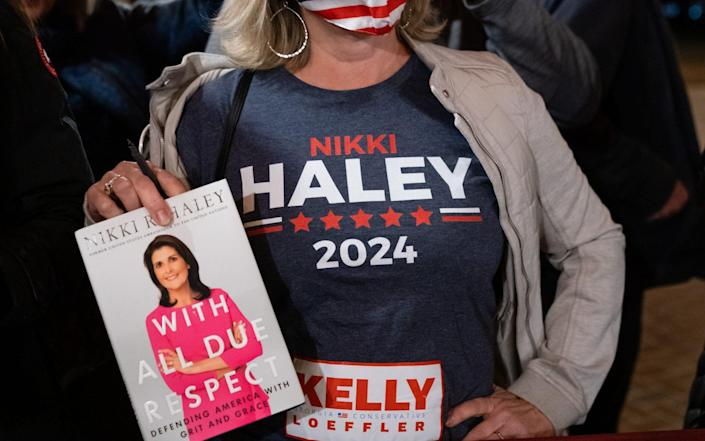 An woman wearing a 'Nikki Haley 2024' t-shirt waits to get a book signed by Nikki Haley, former ambassador to the United Nations - Elijah Nouvelage/Bloomberg