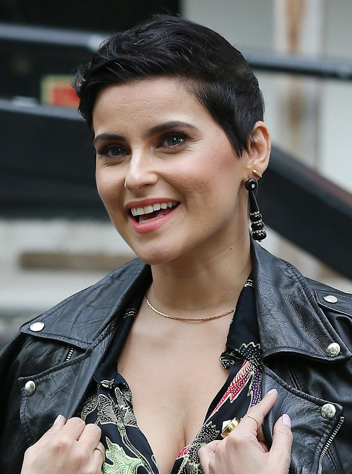 <p>While out and about in Londontown, Nelly Furtado sported this jet-black pixie that added to her edgy leather look. (Photo by Neil Mockford/GC Images) </p>
