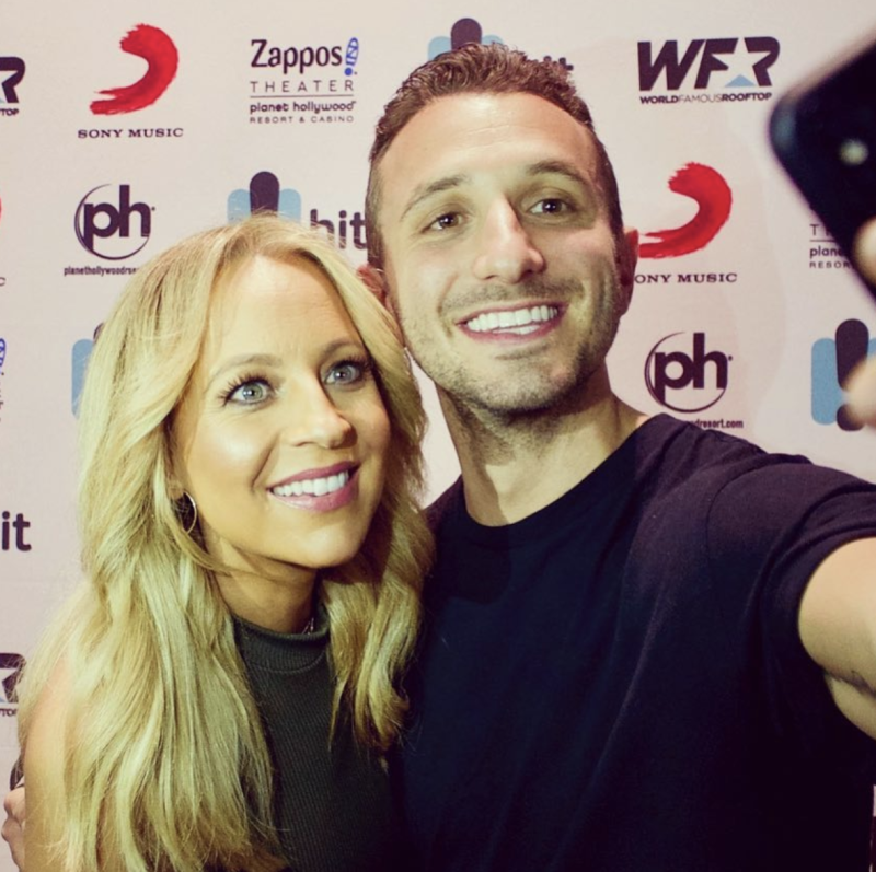 Tommy Little and his radio co-host Carrie Bickmore take a selfie at an event in 2018