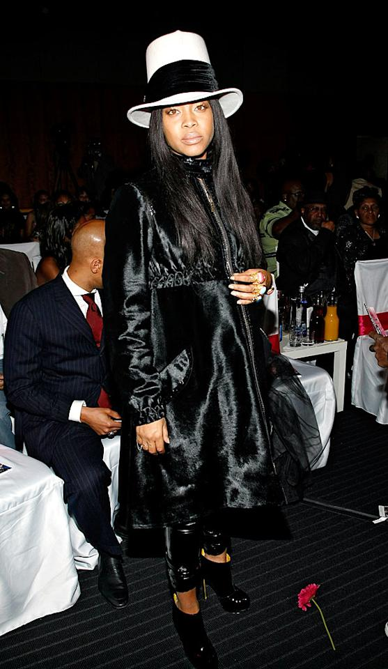 "We'll give Erykah Badu props for her hot heels, but her satin trench and atrocious top hat have got to go! Brian Ach/<a href=""http://www.wireimage.com"" target=""new"">WireImage.com</a> - November 2, 2008"