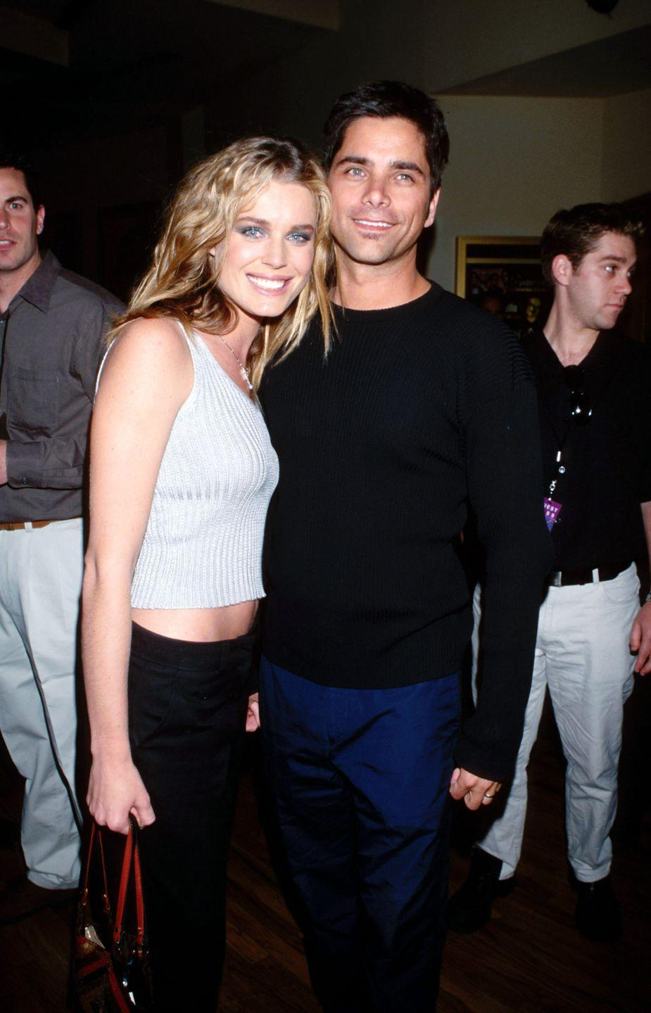 <p>It's a love story like any other, really. They first met at the Victoria's Secret Fashion Show. She was a model, he was television royalty—well, maybe not like any other. They were married from 1998 until 2005. After their divorce, Romijn married Jerry O'Connell in 2007 and had twin daughters. Stamos remained a bachelor until 2018, when he married Caitlin McHugh and welcomed a son, Billy. </p>