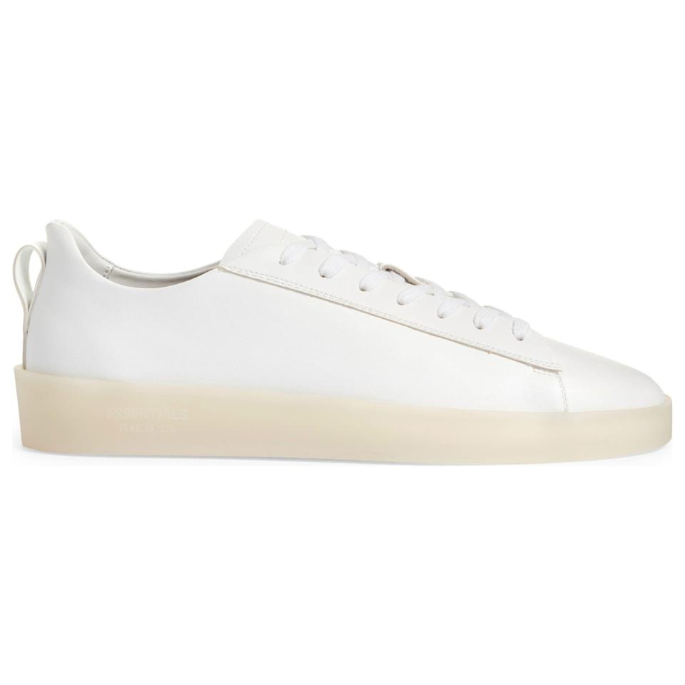 """<p><strong>The Essential Tennis Low Sneaker</strong></p><p>nordstrom.com</p><p><strong>$295.00</strong></p><p><a href=""""https://go.redirectingat.com?id=74968X1596630&url=https%3A%2F%2Fwww.nordstrom.com%2Fs%2Ffear-of-god-essentials-the-essential-tennis-low-sneaker-men%2F5926480&sref=https%3A%2F%2Fwww.esquire.com%2Fstyle%2Fmens-accessories%2Fadvice%2Fg2538%2Fluxury-sneaker-brands-worth-spending-money%2F"""" rel=""""nofollow noopener"""" target=""""_blank"""" data-ylk=""""slk:Shop Now"""" class=""""link rapid-noclick-resp"""">Shop Now</a></p><p>And should those mainline shoes prove too high up the luxury ladder for your pocketbook at the moment, you can always turn to Essentials. These sneakers are made in Italy from recycled calfskin and set upon a translucent sole. They're not cheap by any stretch, but they deliver the much-beloved FoG vibe for a bit less than you'd otherwise pay.</p>"""