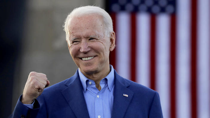 Joe Biden acknowledges the crowd during a campaign rally Saturday in Kansas City, Mo. (Charlie Riedel/AP)