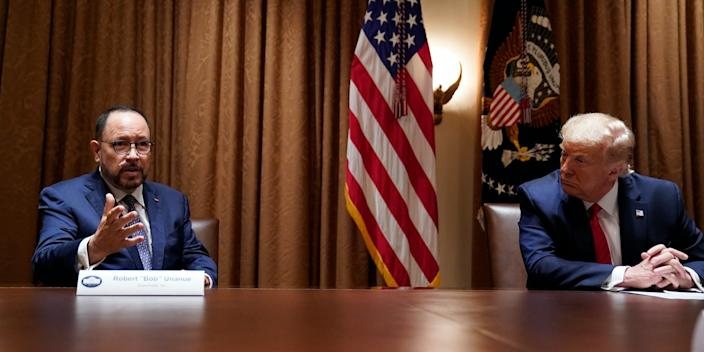 President Donald Trump listens as Robert Unanue, of Goya Foods, speaks during a roundtable meeting with Hispanic leaders in the Cabinet Room, Thursday, July 9, 2020, in Washington.