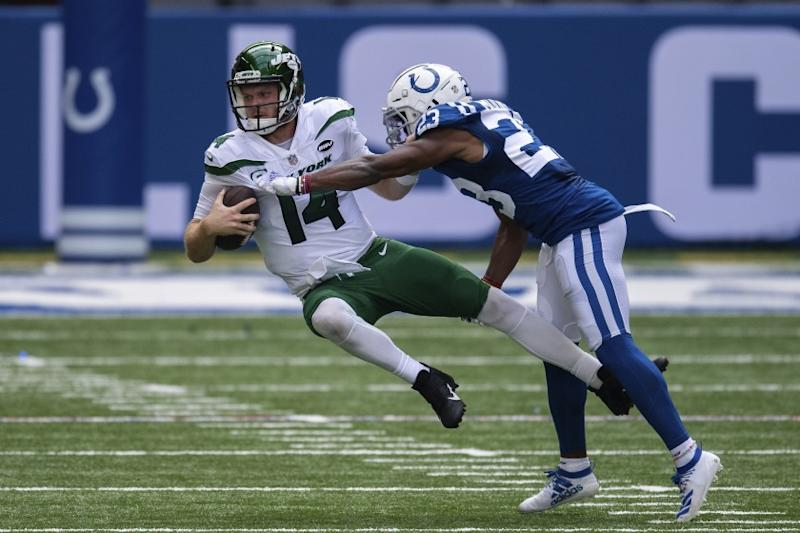 Indianapolis Colts cornerback Kenny Moore (23) sacks New York Jets quarterback Sam Darnold (14) during an NFL football game between the Indianapolis Colts and New York Jets, Sunday, Sept. 27, 2020, in Indianapolis. (AP Photo/Zach Bolinger)