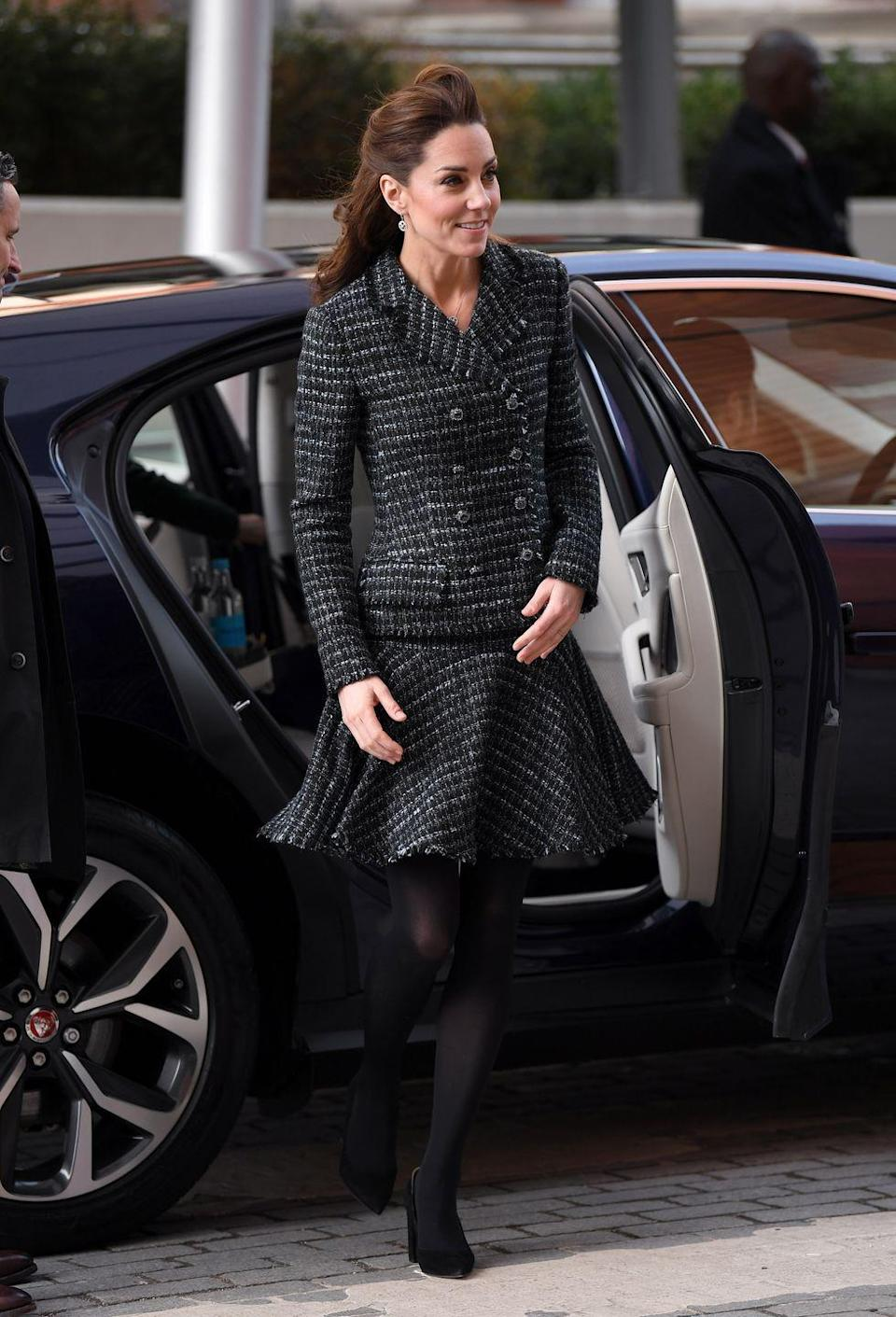 <p>On a visit to Evelina Children's Hospital to attend a National Portrait Gallery Workshop, Kate re-wore a black tweed Dolce & Gabbana skirt suit. <br></p>