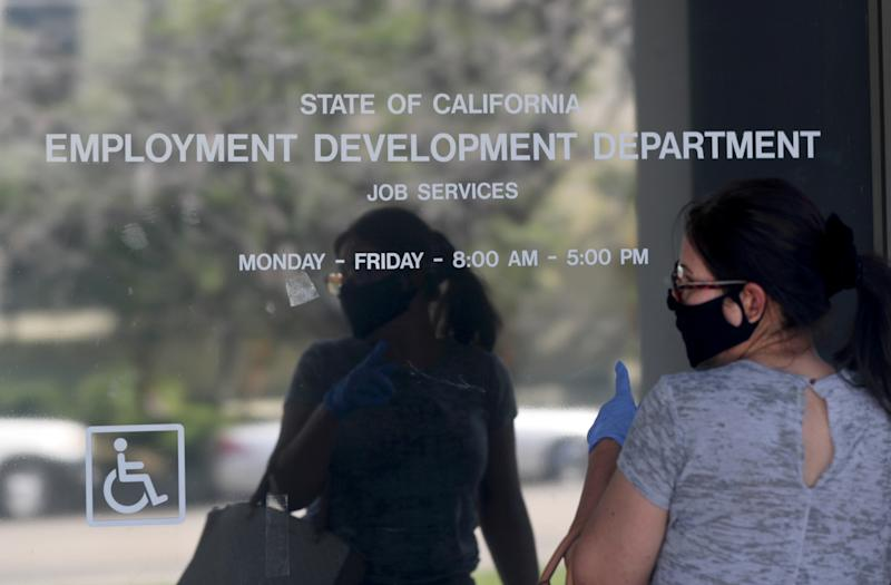 CANOGA PARK, CA - MAY 14: Maria Mora came to find information about her claim but found the California State Employment Development Department was closed due to coronavirus concerns on Thursday, May 14, 2020 in Canoga Park, CA. (Brian van der Brug / Los Angeles Times via Getty Images)