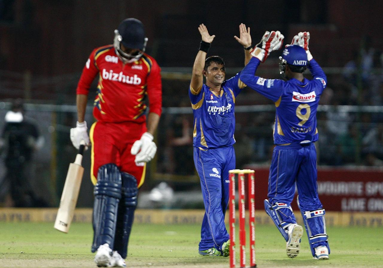 Rajasthan Royals players celebrate fall of wicket during the match between Rajasthan Royals and Lions at Sawai Mansingh Stadium, Jaipur on Sept. 25, 2013. (Photo: IANS)