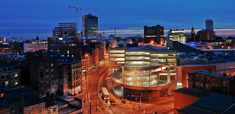 An urban evening view of Manchester in Lancashire, England. This image was taken from the top of a multistorey car park close to the city centre.
