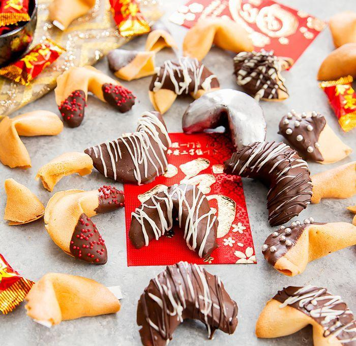 """<p>The crispy, plastic-wrapped cookies that come with your Chinese food were first popularized in California, where they were mass produced for the first time. Homemade fortune cookies have a more personal touch, especially when dipped in chocolate and covered with festive sprinkles.</p><p>Get the recipe from <a href=""""https://kirbiecravings.com/2017/01/homemade-fortune-cookies.html"""" rel=""""nofollow noopener"""" target=""""_blank"""" data-ylk=""""slk:Kirbie's Cravings"""" class=""""link rapid-noclick-resp"""">Kirbie's Cravings</a>.</p>"""