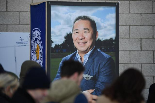 People pause at a portrait of Leicester City Football Club's Thai chairman Vichai Srivaddhanaprabha (AFP/Getty Images)