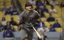 Arizona Diamondbacks' Carson Kelly hits an RBI double during the 13th inning of a baseball game against the Los Angeles Dodgers Saturday, March 30, 2019, in Los Angeles. (AP Photo/Marcio Jose Sanchez)