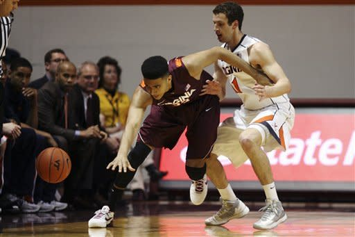 Virginia Tech's Marshall Wood (33) loses the ball out of bounds next to Virginia's Evan Nolte (11) during the first half of their NCAA college basketball game, Thursday, Jan. 24, 2013, in Blacksburg, Va. (AP Photo/The Roanoke Times, Matt Gentry)