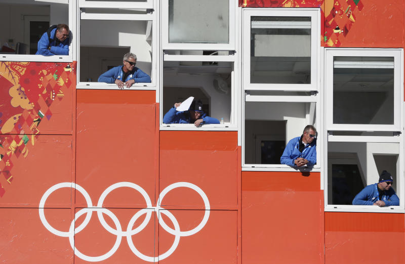 Judges watch an attempt during the men's normal hill ski jumping training at the 2014 Winter Olympics, Friday, Feb. 7, 2014, in Krasnaya Polyana, Russia. (AP Photo/Matthias Schrader)