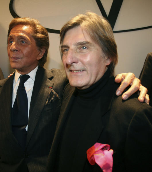 "FILE  - In this Wednesday, Jan. 23, 2008 file photo, Italian fashion designer Valentino, left, celebrates with French designer Emmanuel Ungaro after the presentation of his Haute Couture Spring-Summer 2008 collection, in Paris. Fashion house Emanuel Ungaro says that French designer Emanuel Ungaro has died at the age of 86. The house posted Sunday, Dec. 22, 2019 on Instagram that Ungaro ""will remain in our memories as the Master of sensuality, of color and flamboyance."" Ungaro has died on Saturday in Paris, according to French medias. Renowned for his use of vibrant colors, mixed prints and elegant draping, Ungaro founded the house that bears his name in 1965. He retired from fashion in 2004. (AP Photo/Thibault Camus, File)"