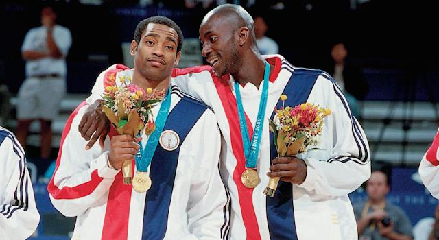 Vince Carter and Kevin Garnett celebrate after taking home Olympic gold in Sydney. (Photo by Andrew D. Bernstein/NBAE via Getty Images)
