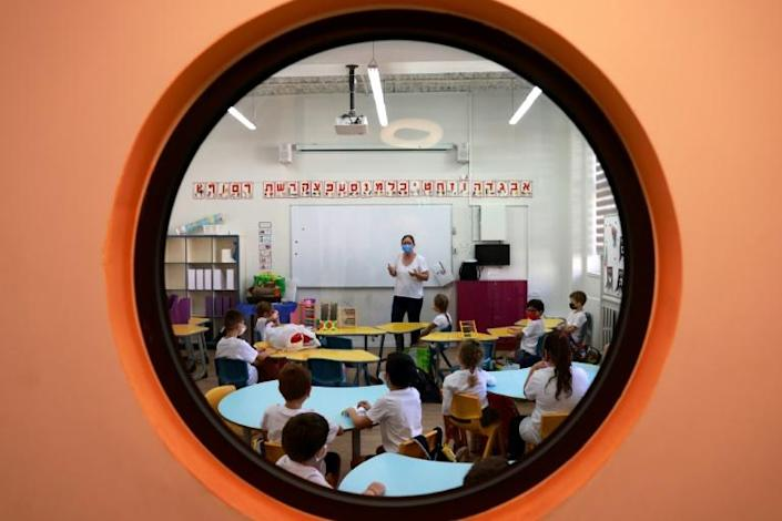 Parents complain their daily routines are now dominated by Covid tests required to get their children readmitted to school after classmates tested positive (AFP/MENAHEM KAHANA)