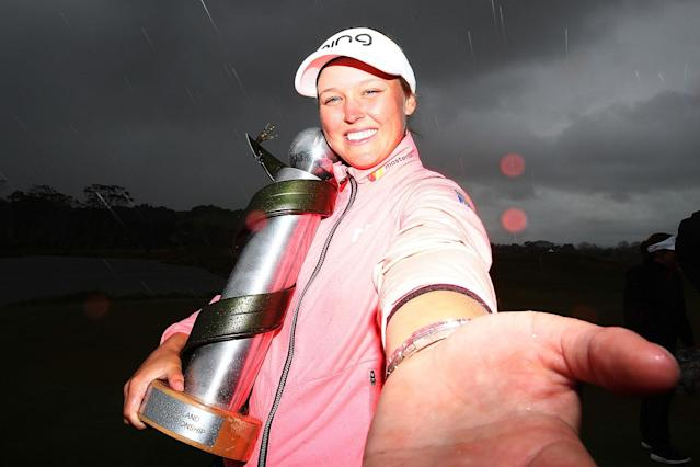 <p>After a breakout season in 2016, Brooke Henderson earned a pair of titles in her follow-up campaign, including this one in New Zealand. (Photo by Hannah Peters/Getty Images) </p>