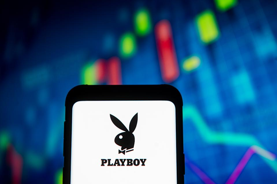 POLAND - 2020/03/23: In this photo illustration a Playboy logo seen displayed on a smartphone. A stock market chart is being displayed as the background. (Photo Illustration by Mateusz Slodkowski/SOPA Images/LightRocket via Getty Images)