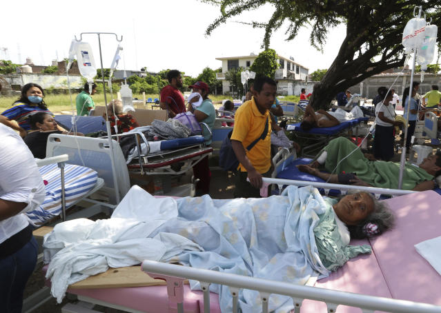 <p>Evacuated patients lie on their hospital beds shaded by a tree, in the aftermath of a massive earthquake, in Juchitan, Oaxaca state, Mexico, Friday, Sept. 8, 2017. One of the most powerful earthquakes ever to strike Mexico hit off its southern Pacific coast, killing at least 32 people, toppling houses, government offices and businesses. (AP Photo/Luis Alberto Cruz) </p>