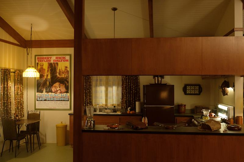 Though movie memorabilia was curated from director Quentin Tarantino's vast collection, the prop department made a fictitious poster from a Rick Dalton film for this classic '60s kitchen.