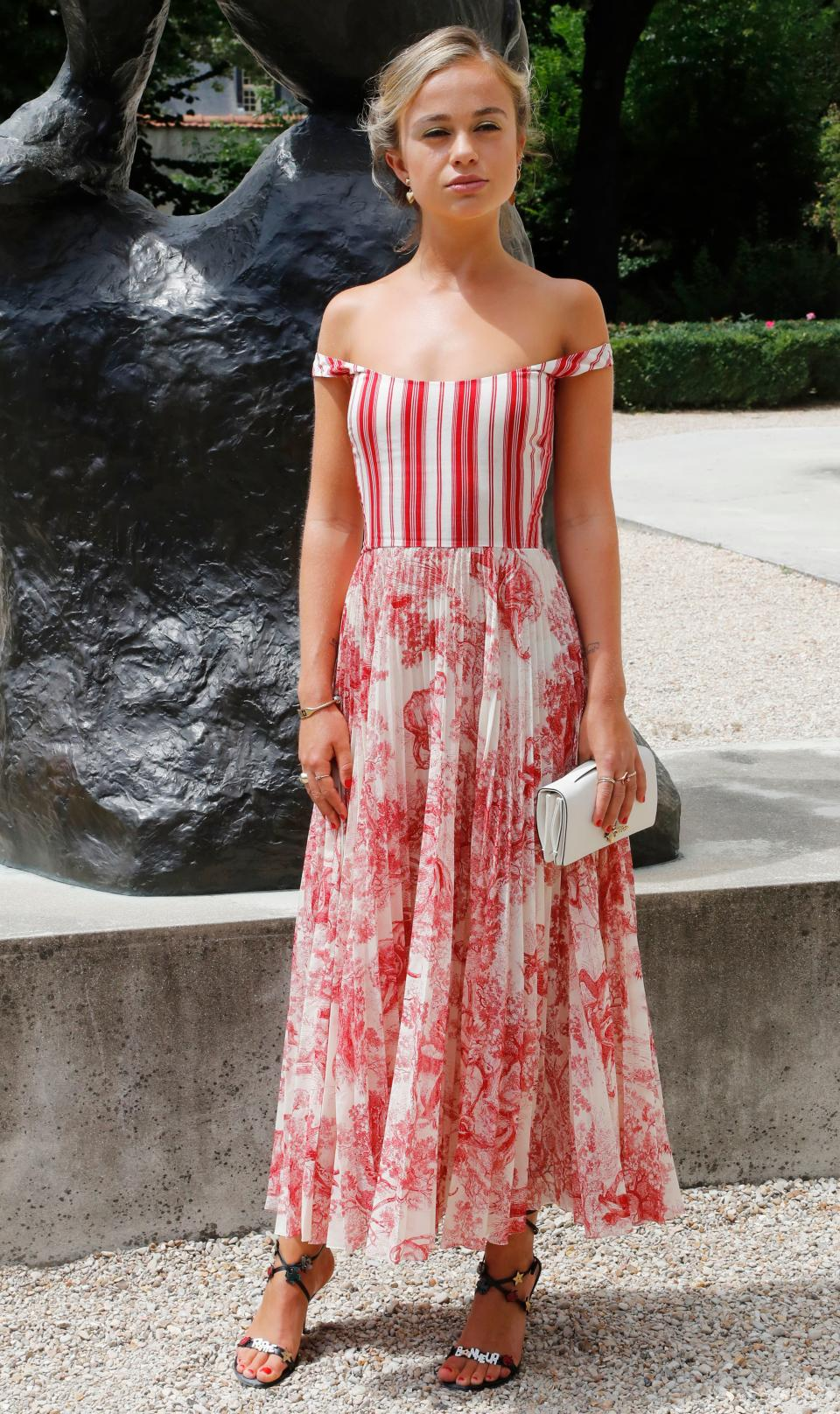 <p>Lady Amelia Windsor donned a cold-shoulder dress to the Christian Dior haute couture show in Paris on 2 July. <em>[Photo: Getty]</em> </p>