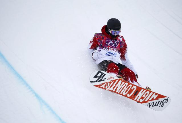 Canada's Derek Livingston crashes during the men's snowboard halfpipe qualification round at the 2014 Sochi Winter Olympic Games in Rosa Khutor February 11, 2014. REUTERS/Dominic Ebenbichler (RUSSIA - Tags: OLYMPICS SPORT SNOWBOARDING)