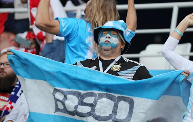 Soccer Football - World Cup - Group D - Argentina vs Croatia - Nizhny Novgorod Stadium, Nizhny Novgorod, Russia - June 21, 2018 Argentina fan inside the stadium holds up a flag before the match REUTERS/Lucy Nicholson