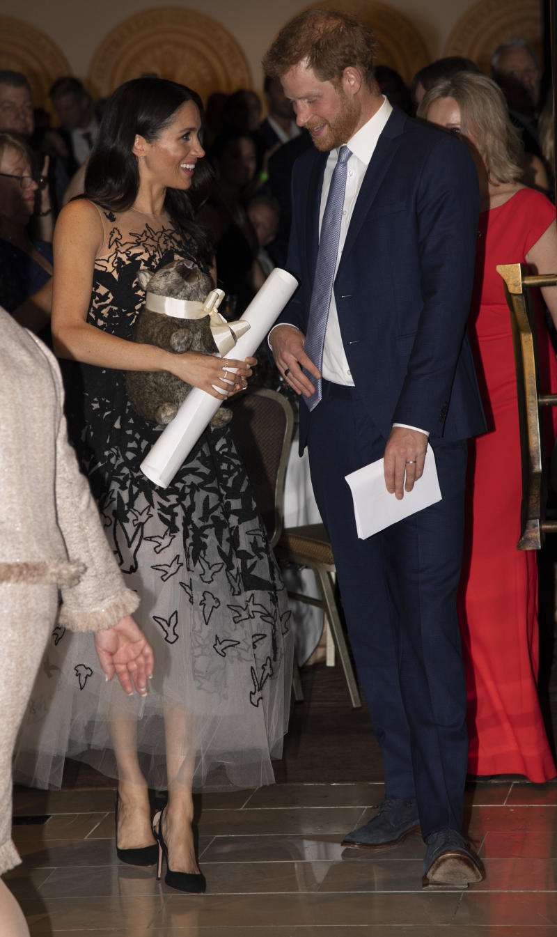 The couple accepting what looks like another baby gift!  (Pool via Getty Images)