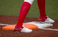 Mexico's Suzannah Brookshire waits on first base during the softball game between Mexico and Canada at the 2020 Summer Olympics, Wednesday, July 21, 2021, in Fukushima , Japan. (AP Photo/Jae C. Hong)