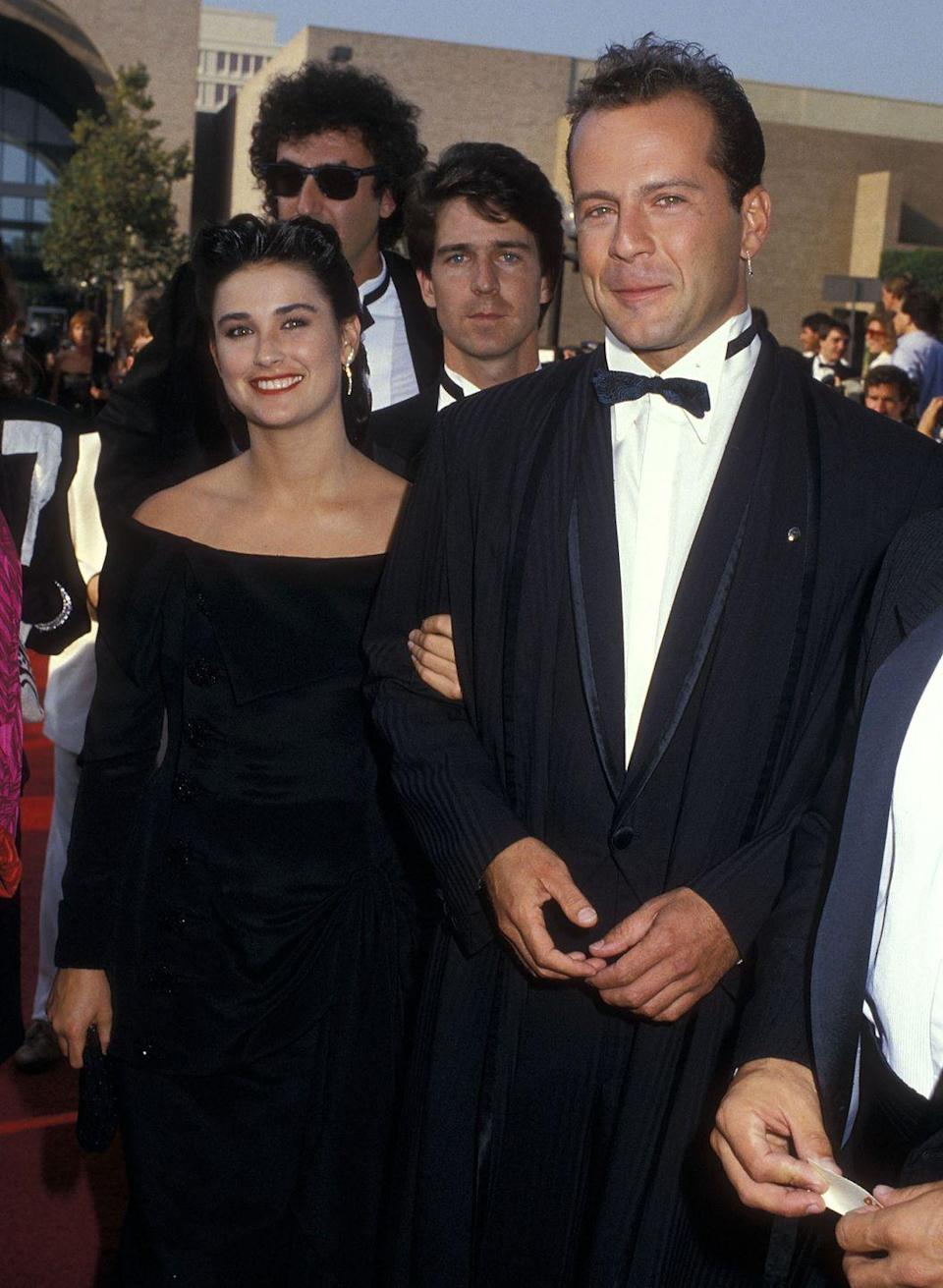 """<p> After just three months of dating, Demi Moore and Bruce Willis called a <a href=""""https://ew.com/article/1997/11/21/bruce-and-demi-celebrate-10-years/"""" rel=""""nofollow noopener"""" target=""""_blank"""" data-ylk=""""slk:reverend from Las Vegas's Little White Chapel"""" class=""""link rapid-noclick-resp"""">reverend from Las Vegas's Little White Chapel</a> and said """"I do"""" in a suite at the Golden Nugget hotel. The couple had three daughters together, but split in 2000. </p>"""