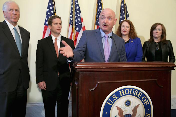 Former astronaut Mark Kelly, husband of former congresswoman and handgun violence survivor Gabby Giffords, is joined by Reps. Mike Thompson (D-Calif.), Bob Dold (R-Ill.), Elizabeth Esty (D-Conn.) and Kathleen Rice (D-N.Y.) for a news conference about background checks for gun purchases in the Canon House Office Building on March 4, 2015.