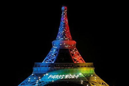Eiffel Tower is lit in the colours of the Olympic flag during the launch of the international campaign for the Paris bid to host the 2024 Olympic Games
