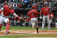 Los Angeles Angels' David Fletcher (6) scores past Chicago White Sox catcher James McCann, left, during the first inning of a baseball game Sunday, Sept. 8, 2019, in Chicago. (AP Photo/Matt Marton)