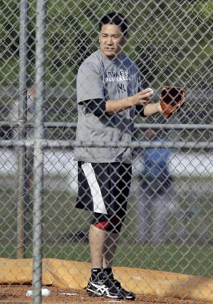 New York Yankees pitcher Masahiro Tanaka, of Japan, throws a bullpen session during practice at the Yankees' minor league facility Thursday, Feb. 13, 2014, in Tampa, Fla. (AP Photo/Chris O'Meara)
