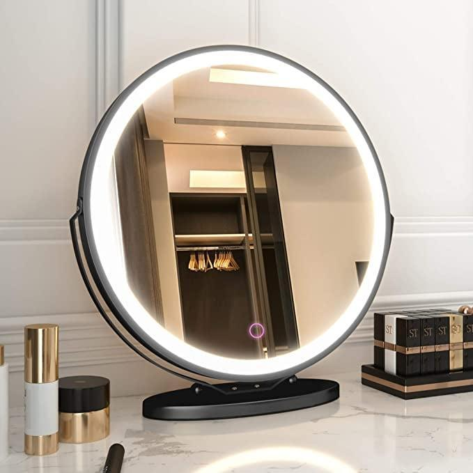 <p>The large <span>LVSOMT Vanity Makeup Mirror with Lights</span> ($66, originally $72) comes in three different colors, black, gold, and white. It has 360 degree rotation and tri-color dimmable LED lights. </p>