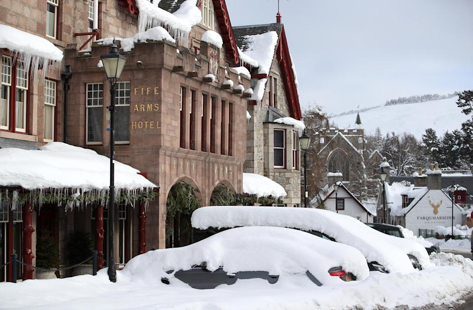 Cars covered in snow in Braemar, Aberdeenshire, which had an overnight temperature of minus 23.0C (minus 9.4F). The village, which is near Balmoral Castle, the summer residence of Queen Elizabeth II, recorded the lowest temperature in the UK in more than two decades, following an