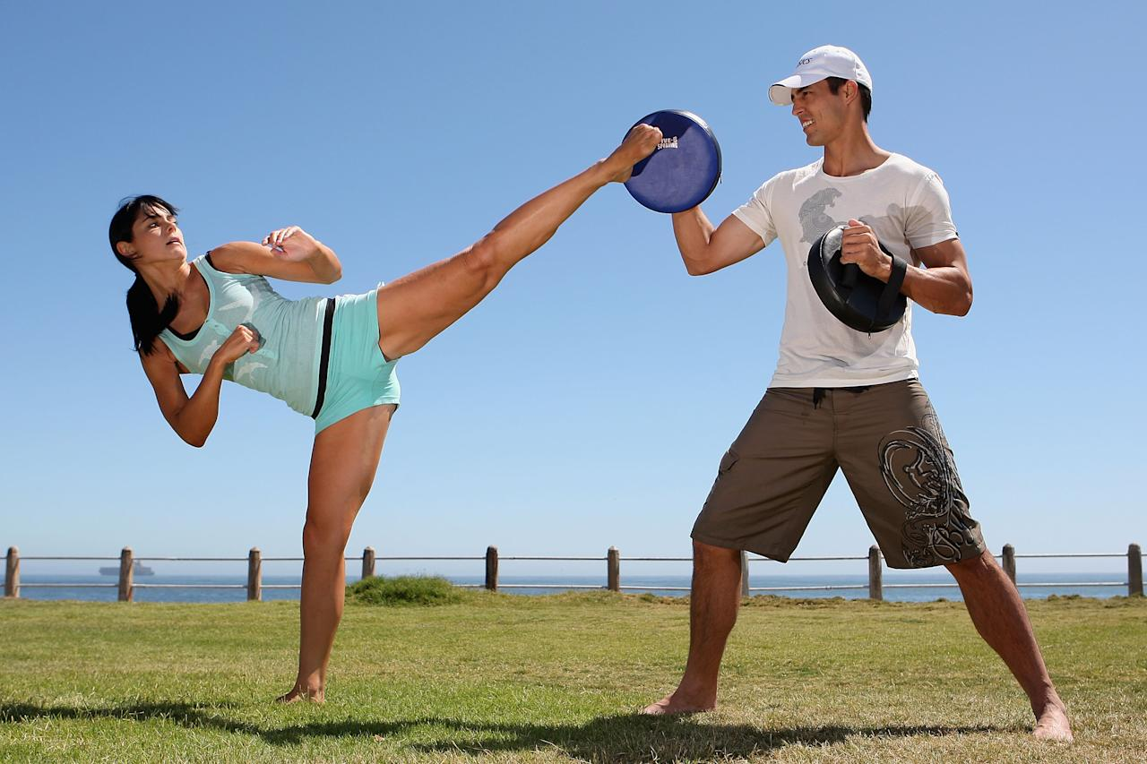 CAPE TOWN, SOUTH AFRICA - MARCH 15:  Mitch Johnson of Australia assists with the karate training of his girlfriend Jessica Bratich at Three Anchor Bay on March 15, 2009 in Cape Town, South Africa. Bratich finished third in her weight division at the 2006 Karate World Championships and has resumed training ahead of the 2010 World Championships. (Photo by Hamish Blair/Getty Images)