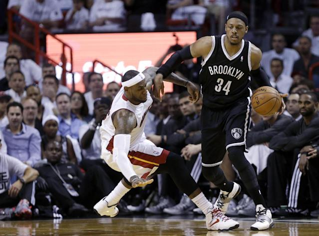 Brooklyn Nets' Paul Pierce (34) is fouled by Miami Heat's LeBron James, left, in the first half of Game 1 in an NBA Eastern Conference semifinal basketball series, Tuesday, May 6, 2014, in Miami. (AP Photo/Lynne Sladky)