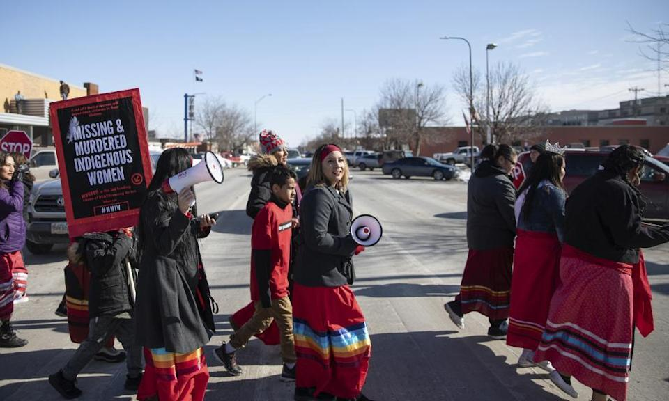 People participate in a march in downtown Rapid City, South Dakota, 14 February 2019, to call attention to missing and murdered Native American women and girls.