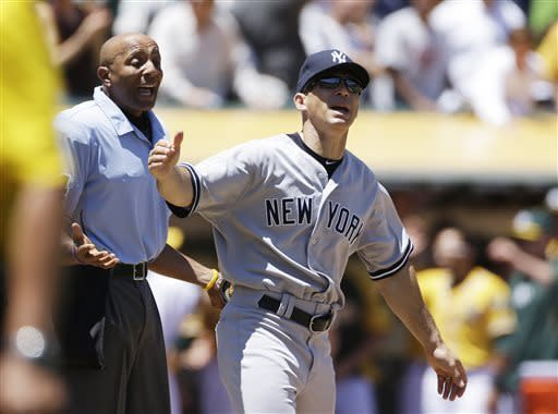 New York Yankees manager Joe Girardi, right, reacts after arguing with home plate umpire CB Bucknor, left, during the third inning of a baseball game against the Oakland Athletics, Thursday, June 13, 2013, in Oakland, Calif. Girardi was arguing after A's John Jaso was called safe at home plate on a double by Seth Smith. (AP Photo/Eric Risberg)