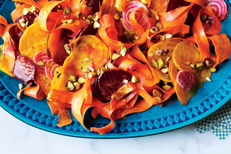 """Smaller beets are ideal for this since the rounds will fit neatly on the end of a fork. <a href=""""https://www.epicurious.com/recipes/food/views/beet-and-carrot-salad-with-curry-dressing-and-pistachios?mbid=synd_yahoo_rss"""" rel=""""nofollow noopener"""" target=""""_blank"""" data-ylk=""""slk:See recipe."""" class=""""link rapid-noclick-resp"""">See recipe.</a>"""