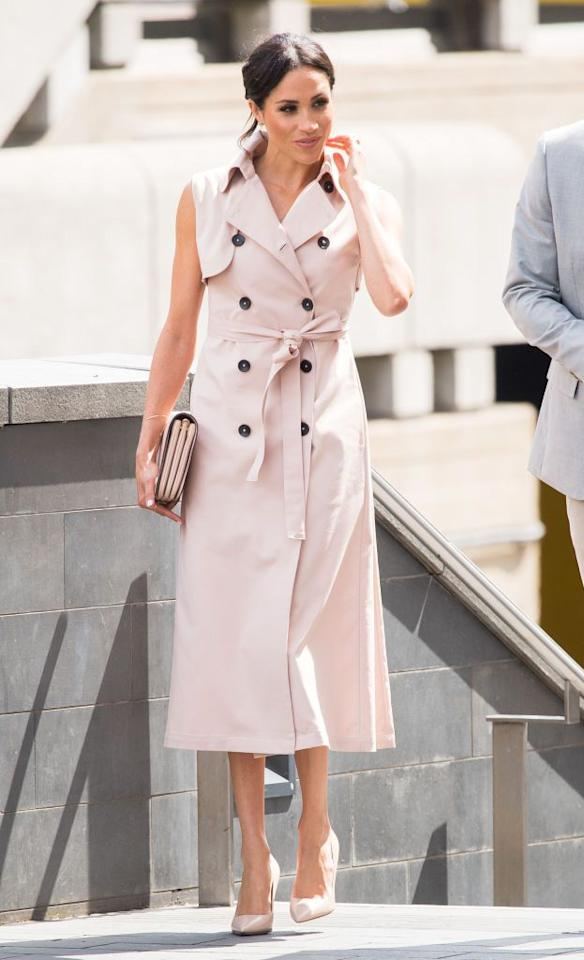 """<p>Meghan Markle stepped out in a blush-colored trench dress by <a rel=""""nofollow"""" href=""""https://www.houseofnonie.com/the-brand.html"""">House of Nonie</a> paired with a matching clutch from Mulberry and coordinating Dior pumps. She wore the look <a rel=""""nofollow"""" href=""""https://www.townandcountrymag.com/style/fashion-trends/a22200767/meghan-markle-classic-trench-coat-nelson-mandela-exhibit/"""">while attending</a> the opening of the Nelson Mandela Centenary Exhibition with Prince Harry.</p>"""