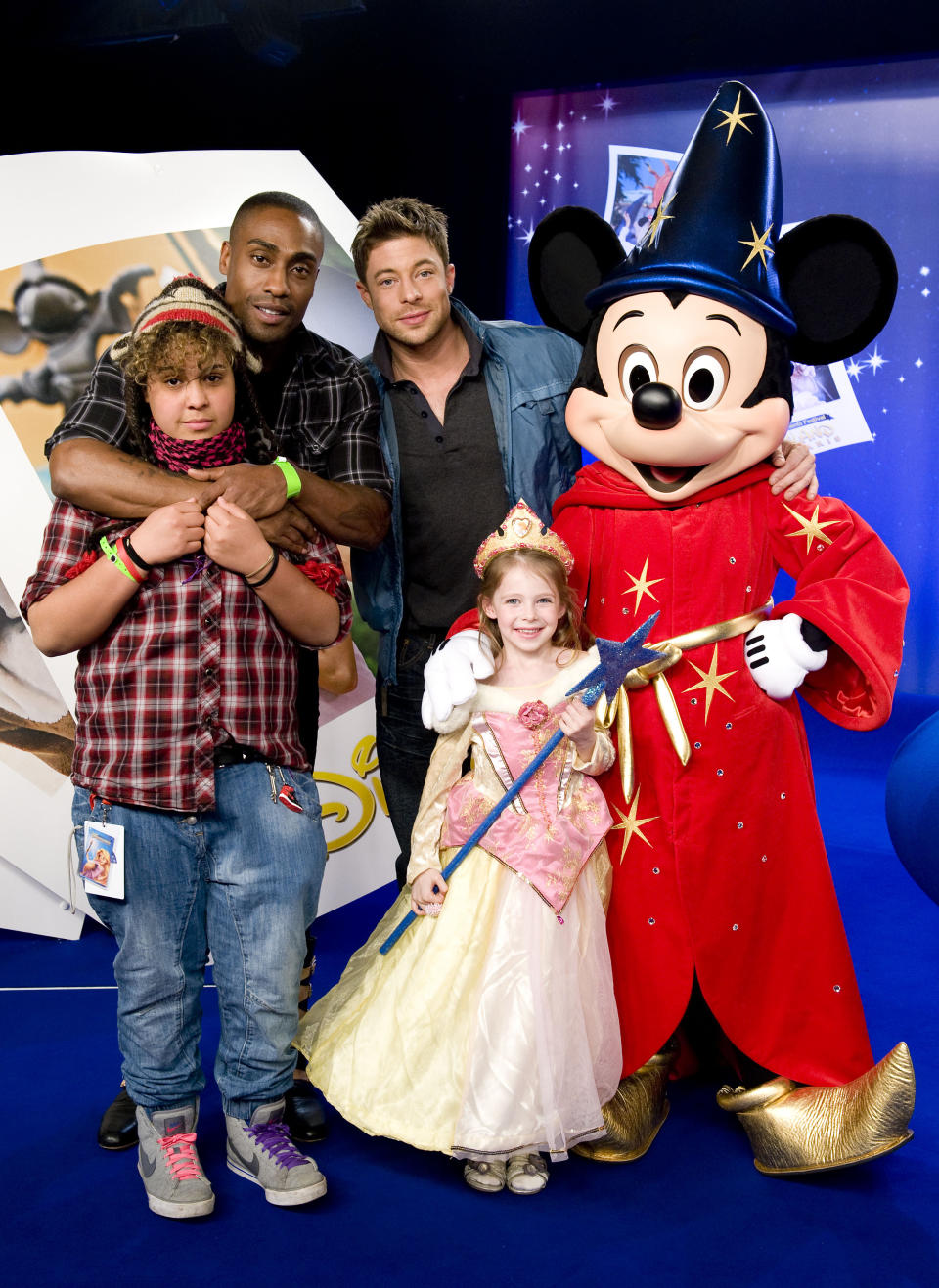 Simon Webb and his daughter Alanah and Duncan James and his daughter Tianie enjoy the Magical Moments Festival at Disneyland, Paris.