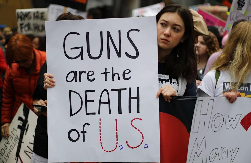 <p>Activists hold signs in Los Angeles. (Photo: Getty Images) </p>