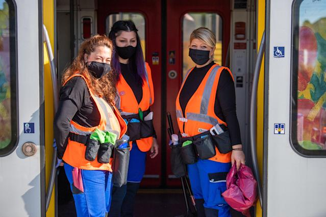 Cleaning staff wear masks in Munich. (Getty Images)