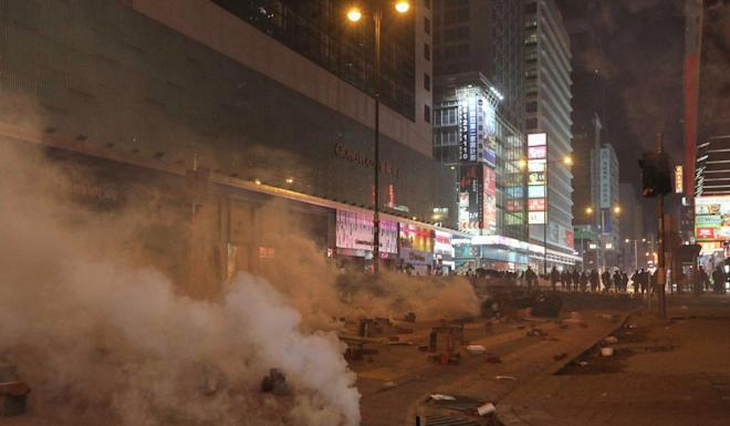 Police fire tear gas on Nathan Road in Mong Kok as the night turns ugly. Photo: Xiaomei Chen