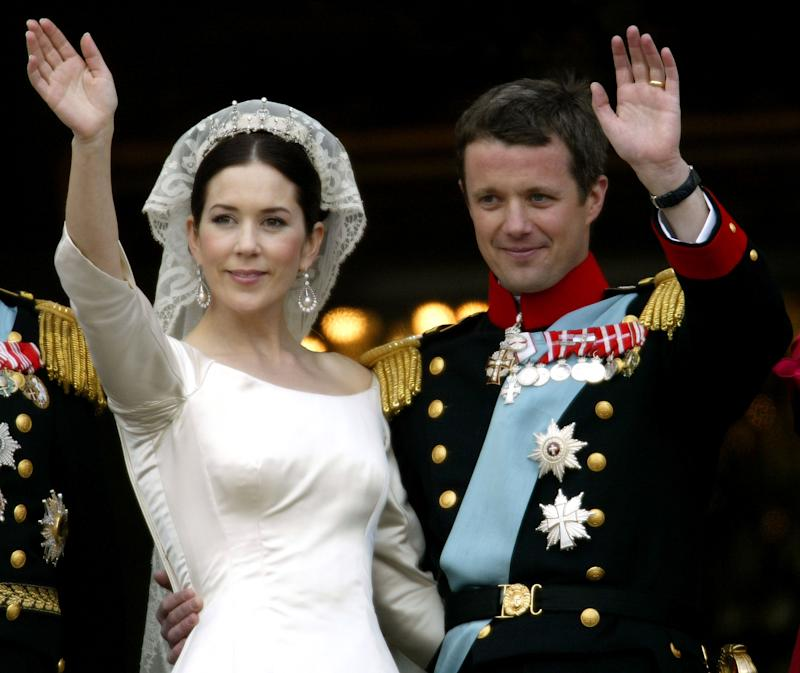 Crown Princess Mary and Crown Prince Frederik of Denmark wave from the balcony of Christian VII's Palace after their wedding May 14, 2004 in Copenhagen, Denmark. The romance began in 2000 when Mary Donaldson met the heir to one of Europe's oldest monarchies over drinks at the Sydney Olympics, where he was with the Danish sailing team.